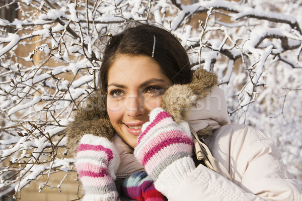 Smiling positive girl among winter twigs Stock photo © pressmaster