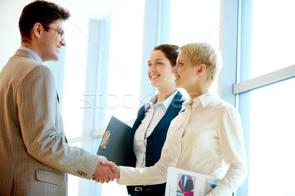 Foto d'archivio: Cooperazione · foto · di · successo · business · partner · business · mano