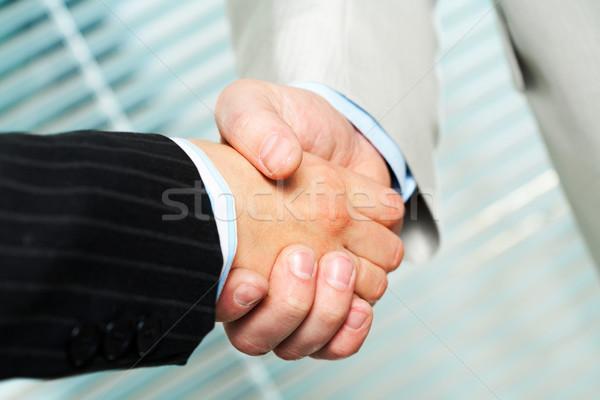 Tárgyalás fotó kézfogás üzleti partnerek készít megállapodás Stock fotó © pressmaster