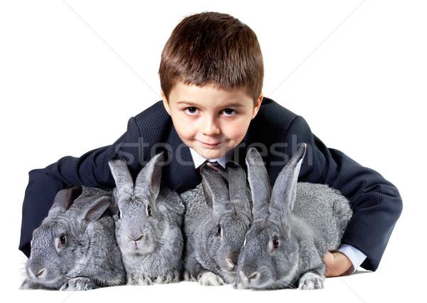 Lad with rabbits Stock photo © pressmaster