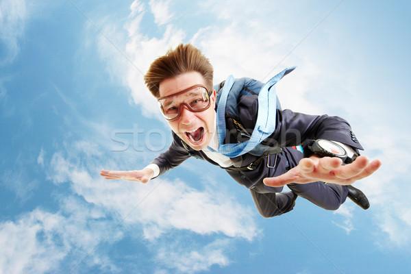 飛行 画像 小さな ビジネスマン 飛行 パラシュート ストックフォト © pressmaster