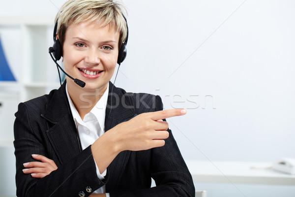 Amichevole receptionist auricolare direzione Foto d'archivio © pressmaster