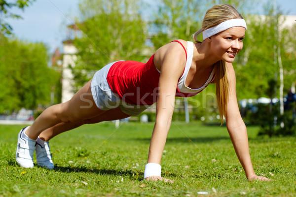 Testmozgás portré fiatal nő természetes környezet Stock fotó © pressmaster