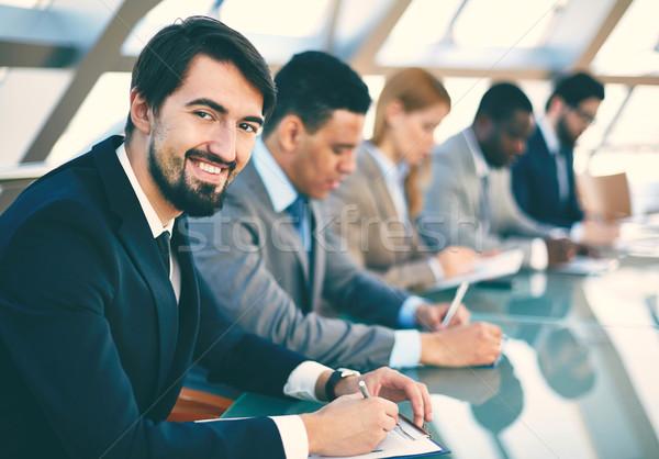 Trabalhando seminário pessoas de negócios escuta apresentação Foto stock © pressmaster