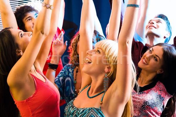 Siker boldog fiatalok lift felfelé kezek Stock fotó © pressmaster