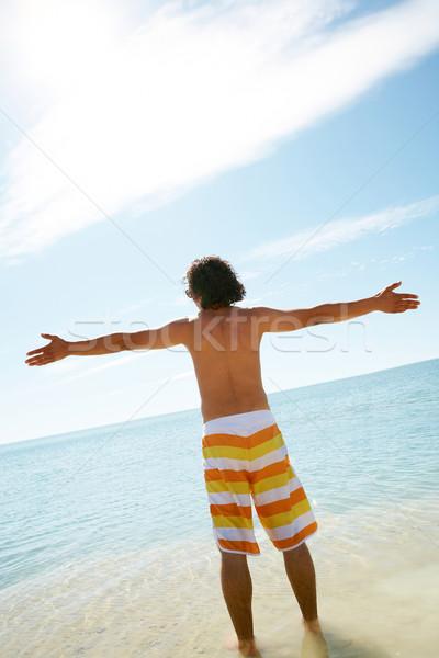 Alegria vida moço em pé azul Foto stock © pressmaster