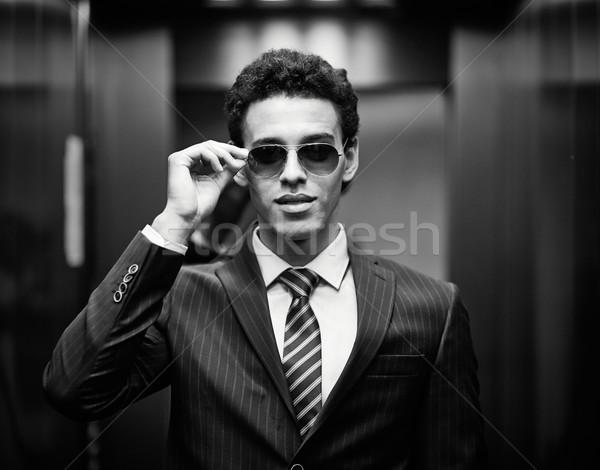 Szykowny człowiek portret garnitur okulary patrząc Zdjęcia stock © pressmaster