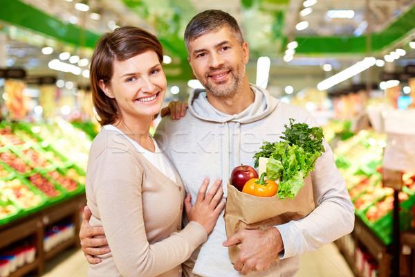 Stock fotó: Boldog · kép · pár · tele · termékek · néz