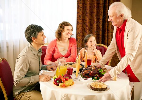 Gathered at dinner table Stock photo © pressmaster