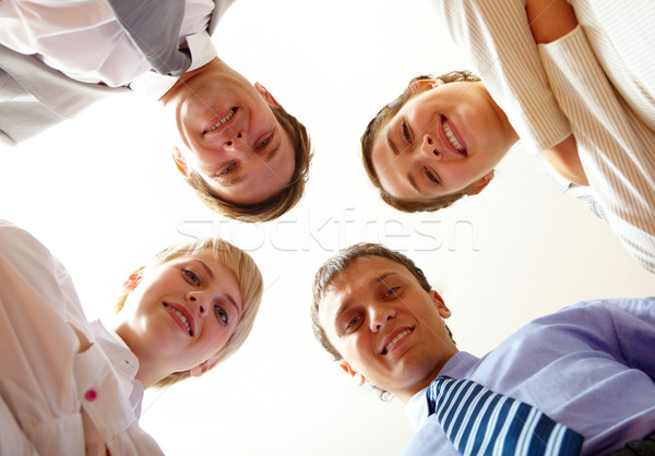 Sotto angolo di Smart uomini d'affari guardando fotocamera Foto d'archivio © pressmaster