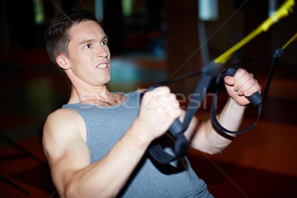 Inspanning jonge man groot moeilijk oefening Stockfoto © pressmaster
