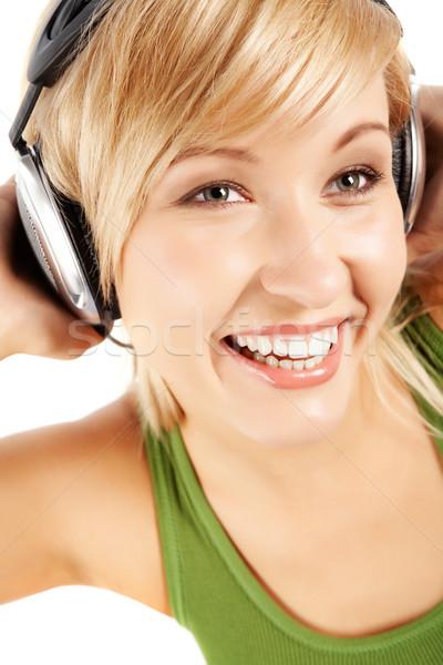 Ritmisch muziek vrolijk meisje hoofdtelefoon luisteren naar muziek Stockfoto © pressmaster