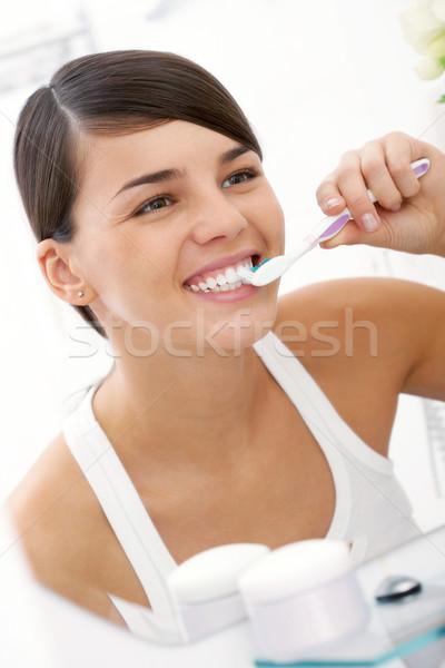 Reggel eljárás kép csinos női fogmosás Stock fotó © pressmaster