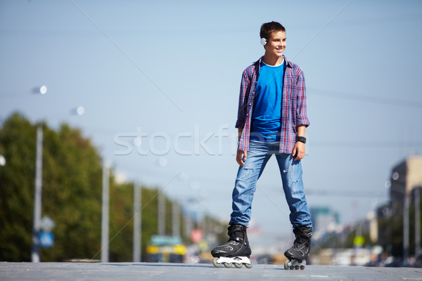 Stock photo: Lad on roller skates