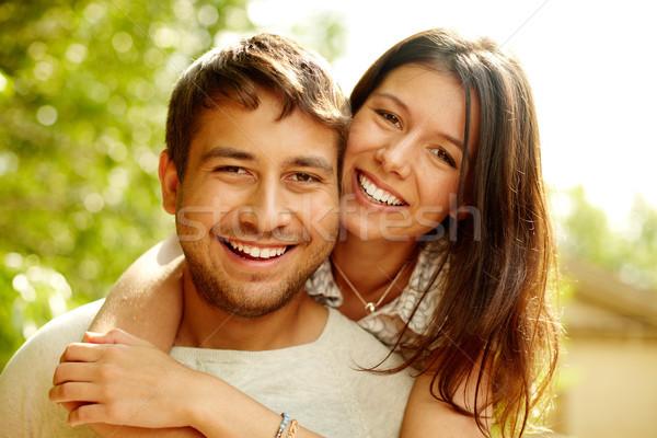 Stockfoto: Liefde · portret · gelukkig · paar · lachend · camera