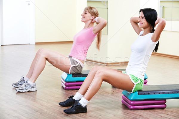 Egzersiz iki kızlar oturma spor salonu Stok fotoğraf © pressmaster