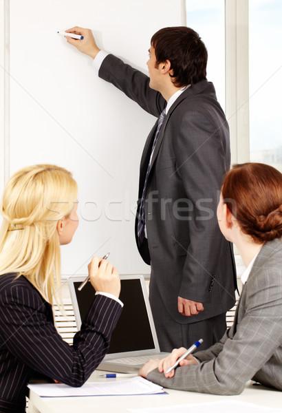 Eligazítás üzletember rajz terv tábla kollégák Stock fotó © pressmaster