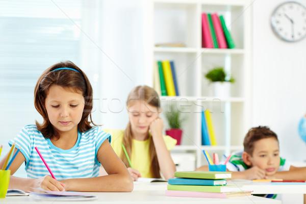 Schoolgirl drawing Stock photo © pressmaster