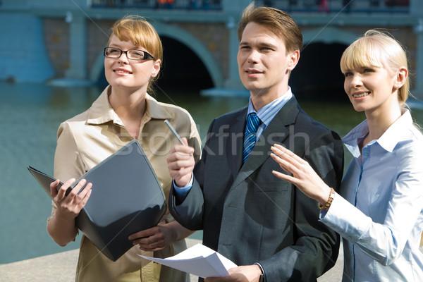 üzleti csoport portré partnerek mutat valami kint Stock fotó © pressmaster