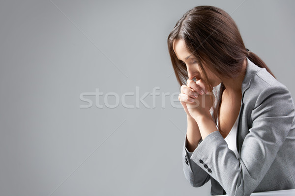 Praying businesswoman Stock photo © pressmaster