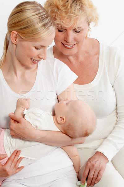 Adorazione ritratto due donne guardando dormire baby Foto d'archivio © pressmaster