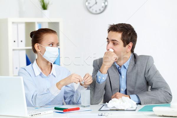 Taking medicine in office Stock photo © pressmaster