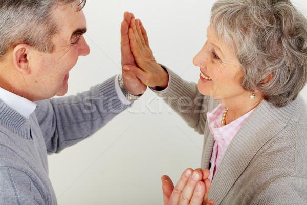 Klejenie powyżej kąt mąż żona dotknąć Zdjęcia stock © pressmaster