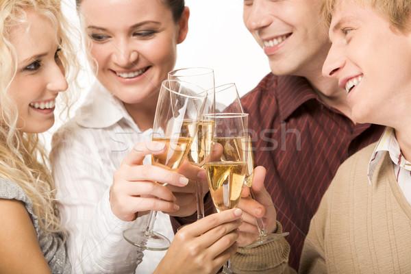 Szczęścia portret radosny znajomych patrząc inny Zdjęcia stock © pressmaster
