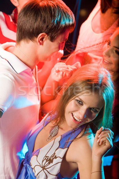 Csinos klubber pozitív fiatal lány szórakozás kör Stock fotó © pressmaster