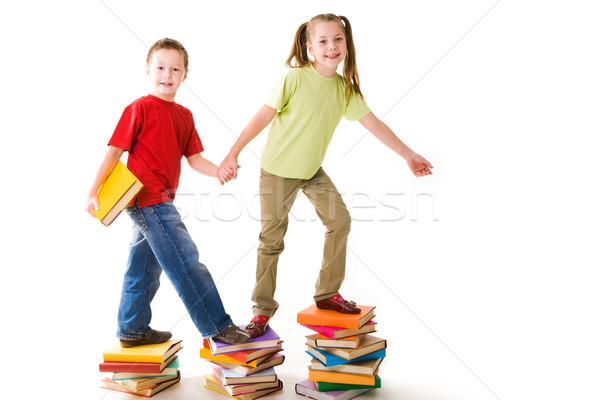 De volta à escola diligente pré-escolares em pé topo livro Foto stock © pressmaster