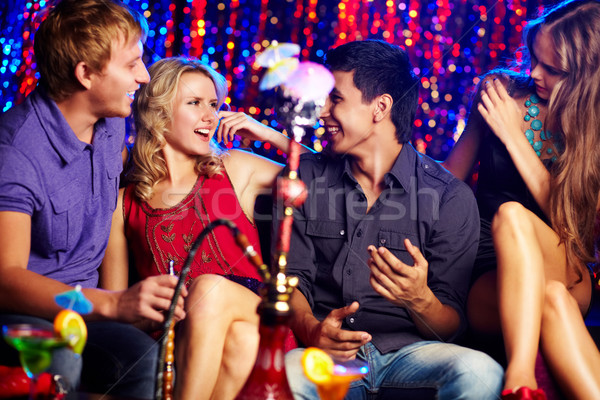 Friends in hookah room Stock photo © pressmaster