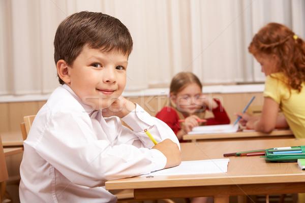 Szorgalmas kép okos iskolás fiú ül asztal Stock fotó © pressmaster