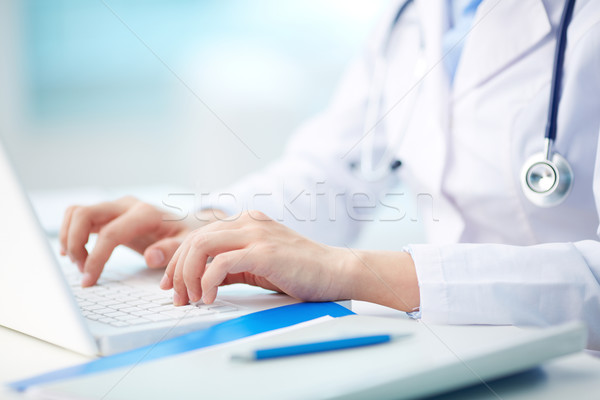 Medical person typing Stock photo © pressmaster