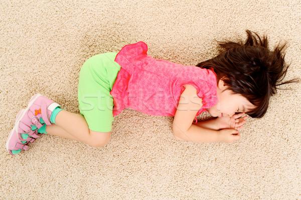Rêve portrait fatigué petite fille dormir étage Photo stock © pressmaster