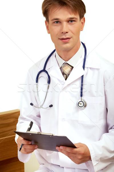 Grave médico retrato estetoscopio mirando cámara Foto stock © pressmaster