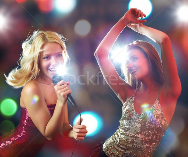 Cheering all night long Stock photo © pressmaster