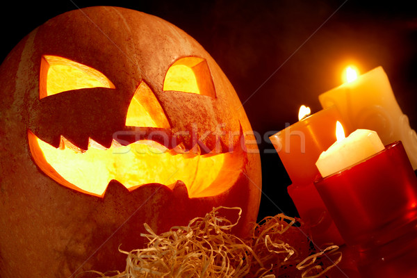 Halloween image grand citrouille brûlant bougie Photo stock © pressmaster