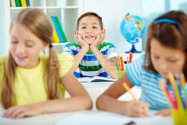 Feliz retrato inteligentes chico lugar de trabajo mirando Foto stock © pressmaster