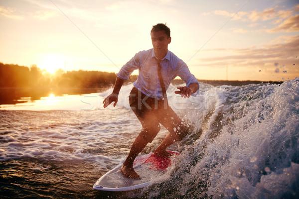 Víz kikapcsolódás fiatalember nedves ruházat nyár Stock fotó © pressmaster