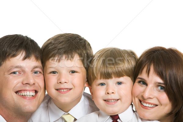 Zdjęcia stock: Wesoły · ludzi · twarze · cztery · rodziny · patrząc