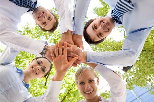 Dolny widoku ludzi ręce Zdjęcia stock © pressmaster