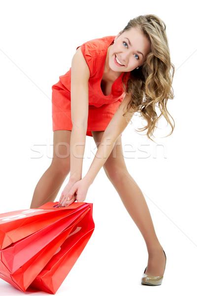 Hordoz szatyrok portré boldog lány piros papírzacskók Stock fotó © pressmaster