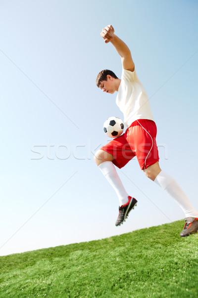 Actif jeu portrait footballeur balle jambe Photo stock © pressmaster