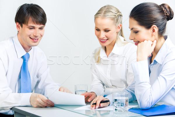 Negócio conversa retrato três pessoas de negócios sessão Foto stock © pressmaster