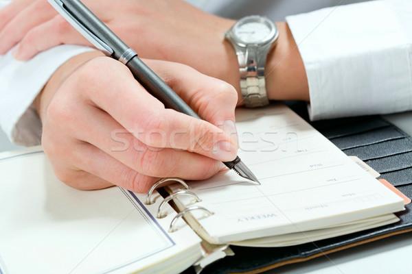 Сток-фото: планирования · рабочих · день · бизнесмен · сведению · блокнот