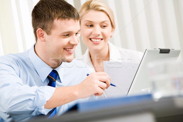 Negocios interacción sonriendo hombre de negocios mujer Foto stock © pressmaster