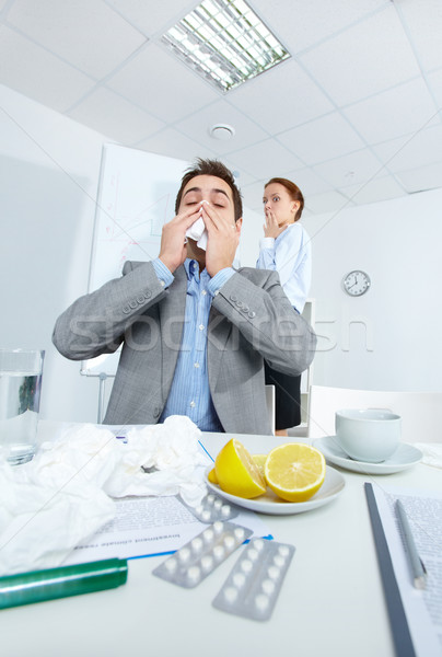 Man sneezing Stock photo © pressmaster
