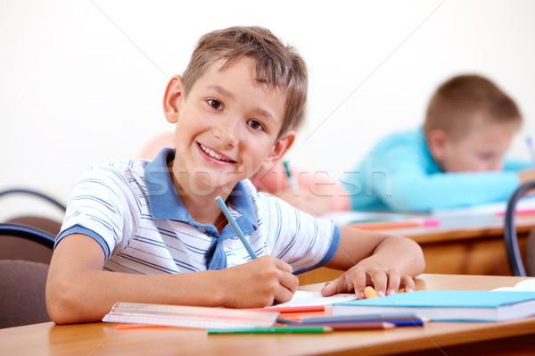 Estudiar escuela retrato inteligentes chico mirando Foto stock © pressmaster