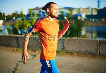 Jogging yapan portre genç çekici kulaklık Stok fotoğraf © pressmaster