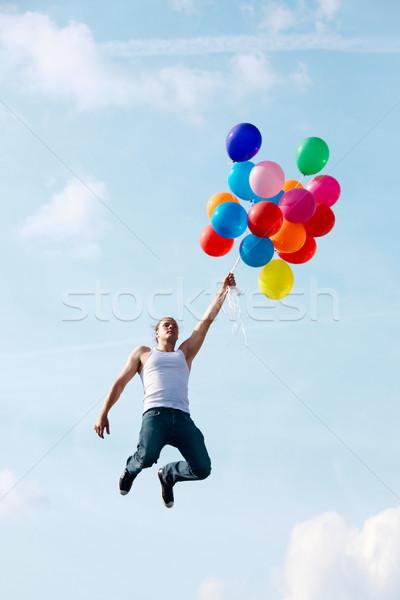 Stock fotó: Repülés · léggömbök · kép · fiatalember · ugrik · tart
